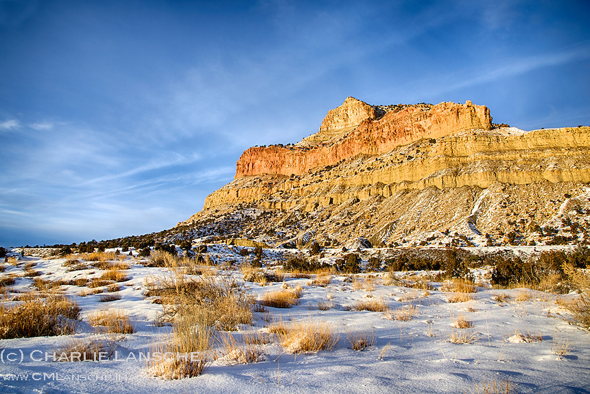 The west facing Book Cliffs are warmed by a December sunset near Horse Canyon.  Emery County, Utah.
