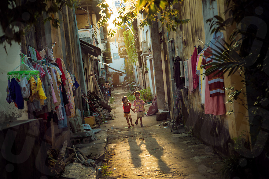 November 13, 2012 - Kampot (Cambodia). Two kids walk in the streets of Kampot, in the south of Cambodia. © Thomas Cristofoletti / Ruom