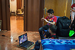 21/10/14. Erbil, Iraq. Wassam (top) and Milad watch an animation on their uncle Salam's laptop in their cousin Alin's room.