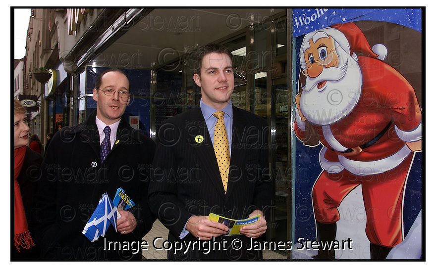 29th November 2000     Copyright Pic : James Stewart .Ref :                           .File Name : stewart21-snpfalkirkwest.SNP'S FALKIRK WEST CANDIDATE DAVID KERR HOPES FOR AN EARLY XMAS PRESENT FROM SANTA AS HE LAUNCHES THE SNP CAMPAIGN WITH LEADER JOHN SWINNEY AND ROSANNA CUNNINGHAM....Payments to :-.James Stewart Photo Agency, Stewart House, Stewart Road, Falkirk. FK2 7AS      Vat Reg No. 607 6932 25.Office : +44 (0) 1324 630007        Mobile : 07721 416997.Fax     : +44 (0) 1324 630007.E-mail : jim@jspa.co.uk.If you require further information then contact Jim Stewart on any of the numbers above.........