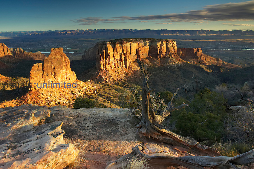 Sunrise warms the sandstone pillars and walls of Colorado National Monument, Colorado, USA.
