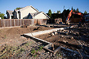 Only the concrete border of a house foundation remains after demolition. A large 4,060 square foot two-story single family house will be built on the site. Cupertino, California, USA