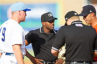 Umpire C.J. Davis (center) meets at home plate with Burlington Royals manager Tommy Shields (19), Greeneville Astros manager Josh Bonifay (17)  and home plate umpire Matt Davis prior to the game at Burlington Athletic Park on June 29, 2014 in Burlington, North Carolina.  The Royals defeated the Astros 11-0. (Brian Westerholt/Four Seam Images)