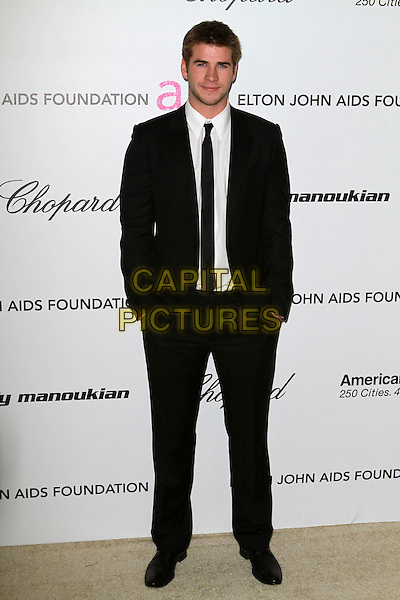LIAM HEMSWORTH.19th Annual Elton John AIDS Foundation Academy Awards Viewing Party held at The Pacific Design Center, West Hollywood, California, USA..February 27th, 2911.full length black suit hands in pockets tie white shirt .CAP/ADM/FS.©Faye Sadou/AdMedia/Capital Pictures.
