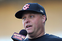 Head coach Chad Holbrook of the South Carolina Gamecocks is interviewed on TV during the Reedy River Rivalry game against the Clemson Tigers on March 1, 2014, at Fluor Field at the West End in Greenville, South Carolina. South Carolina won, 10-2. (Tom Priddy/Four Seam Images)