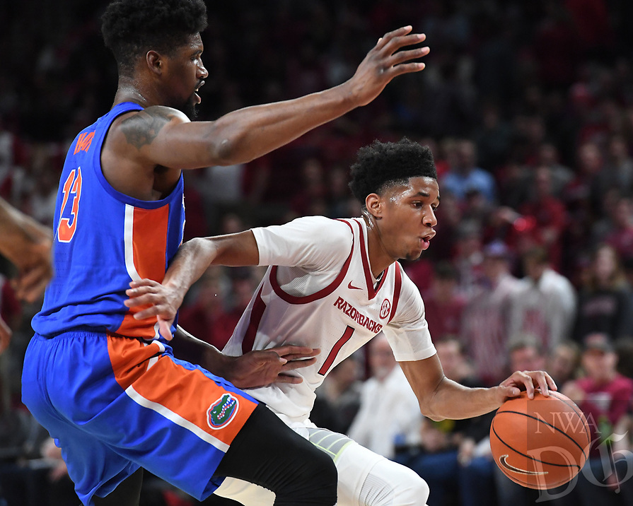 NWA Democrat-Gazette/J.T. WAMPLER Arkansas' Isaiah Joe drives to the basket past Florida's Kevarrius Hayes Wednesday Jan. 9, 2019 at Bud Walton Arena in Fayetteville.