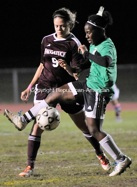 TORRINGTON, CT - 17 October 2012-101712EC08--    Torrington's Toni Wilson takes control of the ball against Naugatuck's Stephanie Lima Wednesday night at Torrington High.  Erin Covey Republican-American.
