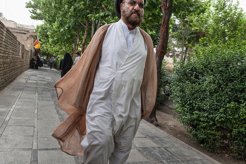 A mullah walks the street of Isfahan.