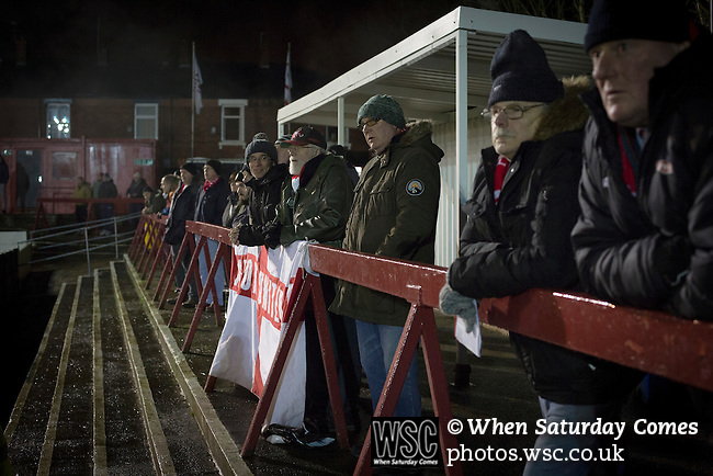 Ashton United 6 Ramsbottom United 0, 12/01/2016. Hurst Cross stadium, Northern Premier League. Home team supporters watching the action during the first-half of the fixture between Ashton United (in red) and Ramsbottom United in the Northern Premier League premier division. The match was played at Ashton's Hurst Cross stadium, the club's ground. The club was originally founded in 1878 as Hurst F.C. and by 1880 the club were playing at Hurst Cross, their current ground which makes their home one of the oldest football grounds in the world. Ashton won the match 6-0, watched by a crowd of 178. Photo by Colin McPherson.