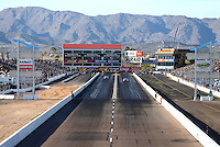 Feb 25, 2017; Chandler, AZ, USA; Overall view of Wild Horse Pass Motorsports Park as NHRA pro stock driver Greg Anderson (right) races alongside teammate Jason Line during qualifying for the Arizona Nationals. Mandatory Credit: Mark J. Rebilas-USA TODAY Sports