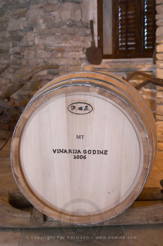 Oak barrel in the tasting room marked with Vinarija Godine 2006 Winery. Toreta Vinarija Winery in Smokvica village on Korcula island. Vinarija Toreta Winery, Smokvica town. Peljesac peninsula. Dalmatian Coast, Croatia, Europe.