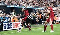 Newcastle United's Ayoze Perez is fouled by Liverpool's Alberto Moreno<br /> <br /> Photographer Rich Linley/CameraSport<br /> <br /> The Premier League -  Newcastle United v Liverpool - Sunday 1st October 2017 - St James' Park - Newcastle<br /> <br /> World Copyright &copy; 2017 CameraSport. All rights reserved. 43 Linden Ave. Countesthorpe. Leicester. England. LE8 5PG - Tel: +44 (0) 116 277 4147 - admin@camerasport.com - www.camerasport.com