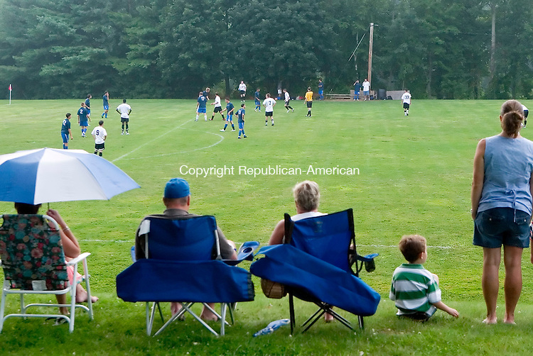 WATERBURY, CT- 03 AUG 2007- 080307JT10- <br /> Spectators watch youth soccer at the 21st annual Festa di San Donato at the Pontelandolfo Club in Waterbury on Friday. <br /> Josalee Thrift / Republican-American