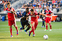 Freddy Adu (11) of the Philadelphia Union tries to slow Gonzalo Segares (13) of the Chicago Fire. The Chicago Fire defeated the Philadelphia Union 3-1 during a Major League Soccer (MLS) match at PPL Park in Chester, PA, on August 12, 2012.