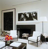 A black and white scheme lends a crisp appearance to the media room, where a screen descends for watching movies