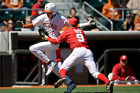 Nebraska Cornhusker pitcher Khris Tate tags out Texas Longhorn Cohl Walla as he tries to score on Sunday March 21st, 2100 at UFCU Dish-Falk Field in Austin, Texas.  (Photo by Andrew Woolley / Four Seam Images)