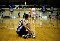 Saints import Eric Devendorf watches play go on after going down injured during the NBL match between the Wellington Saints and Nelson Giants at TSB Bank Arena, Wellington, New Zealand on Friday, 21 May 2010. Photo: Dave Lintott / lintottphoto.co.nz
