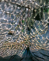 Water reflections on rock wall along the North Santiam River in Marion County Oregon