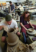 Junior art major Thomas Dambach (L) and senior Spanish major Diana Dembeck (R) throw pots during a ceramics class taught by lecturer Bruce Howdle in the Mosse Humanities Building.<br /> <br /> Client: University of Wisconsin-Madison<br /> &copy; UW-Madison University Communications 608-262-0067<br /> Photo by: Michael Forster Rothbart<br /> Date:  04/02     File#:   0204-94c-35.