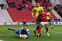 Oxford goalkeeper, Simon Eastwood, makes a save at the feet of Charlton's Mark Marshall during Charlton Athletic vs Oxford United, Sky Bet EFL League 1 Football at The Valley on 3rd February 2018