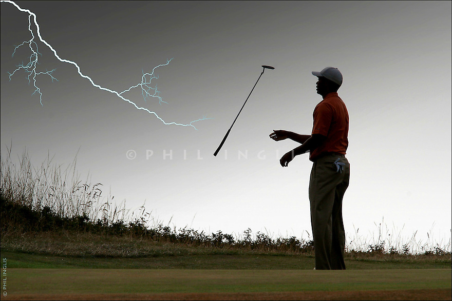Lightning forces Tiger's putter to fly out of his hands during the Open Championship at Royal Liverpool Golf Club on the 22nd July 2006. Picture Credit / Phil Inglis  (THIS IMAGE HAS BEEN ALTERED BY ADDING LIGHTNING IN PHOTOSHOP AS AN APRIL FOOL REQUEST)