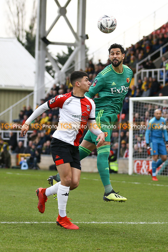 Miguel Angel Britos of Watford and Toby Edser of Woking during Woking vs Watford, Emirates FA Cup Football at The Laithwaite Community Stadium on 6th January 2019