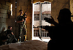 Free Syria Army soldiers prepare to ignite a home-made bomb which was placed next to a building housing several Assad forces during urban fighting in the al-Amaria district of Aleppo...© Javier Manzano.