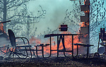 August 17, 1992 Angels Camp, California -- Old Gulch Fire— Only some hardy outdoor furniture remains at house on Fricot City Road.  The Old Gulch Fire raged over some 18,000 acres, destroying 42 homes while threatening the Mother Lode communities of Murphys, Sheep Ranch, Avery and Forest Meadows.