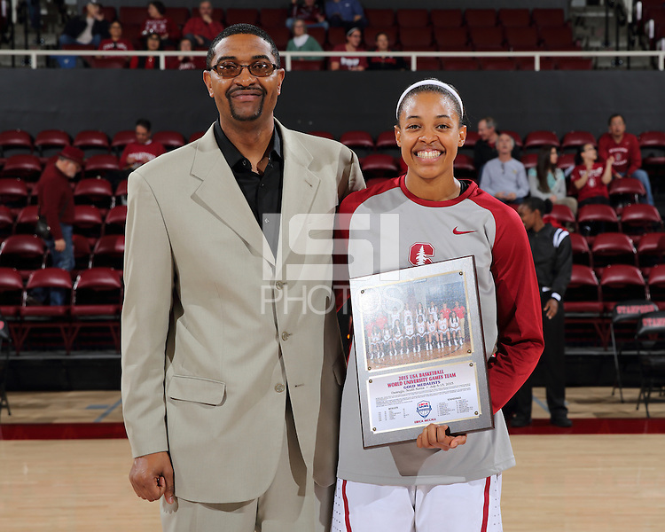 STANFORD, CA - December 22, 2015: Stanford defeats CSU Bakersfield 83-41 at Maples Pavilion. Erica McCall is recognized for her summer with USA Basketball by her father, CSU Bakersfield head coach, Greg McCall.