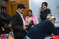 Brinda's son plays with a lawyer during a short break in between legal team sessions during the preparation for her final witness statement in the Guria office in Varanasi, Uttar Pradesh, India on 22 November 2013. She is one of the 57 underaged and trafficked girls rescued from the Shivdaspur red light area in Varanasi, who has been fighting a court case against her traffickers and brothel owners for the past 8 years.
