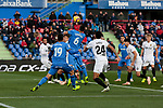 Getafe CF's Jorge Molina (L) and Leandro Cabrera (R) and Valencia CF's Ezequiel Garay during La Liga match between Getafe CF and Valencia CF at Coliseum Alfonso Perez in Getafe, Spain. November 10, 2018.