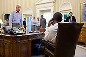"July 31, 2011.""The Vice President and other staff watch and listen as the President talks on the phone in the Oval Office with Senate Majority Leader Harry Reid during the debt limit and deficit discussions."" .Mandatory Credit: Pete Souza - White House via CNP"