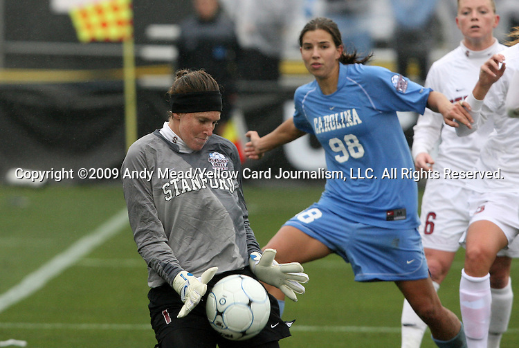 06 December 2009: Stanford's Kira Maker (1) makes a save in front of North Carolina's Tobin Heath (98). The Stanford University Cardinal played the University of North Carolina Tar Heels at Aggie Soccer Stadium in College Station, Texas in the NCAA Division I Women's College Cup Championship game.
