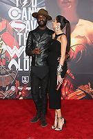 LOS ANGELES, CA - NOVEMBER 13: Gary Clark Jr., Nicole Trunfio, at the Justice League film Premiere on November 13, 2017 at the Dolby Theatre in Los Angeles, California. Credit: Faye Sadou/MediaPunch /NortePhoto.com