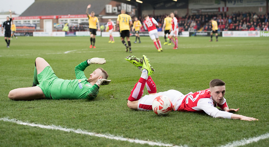 Fleetwood Town's Ashley Hunter collides with Bolton Wanderers' Ben Alnwick<br /> <br /> Photographer Terry Donnelly/CameraSport<br /> <br /> The EFL Sky Bet League One - Fleetwood Town v Bolton Wanderers - Saturday 11th March 2017 - Highbury Stadium - Fleetwood<br /> <br /> World Copyright &copy; 2017 CameraSport. All rights reserved. 43 Linden Ave. Countesthorpe. Leicester. England. LE8 5PG - Tel: +44 (0) 116 277 4147 - admin@camerasport.com - www.camerasport.com