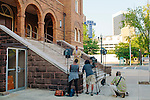 An NBC television crew tapes a segment on the steps of 16th Street Baptist Church in downtown Birmingham, Alabama. In 1963, four girls were killed when a bomb under the church's side steps went off.