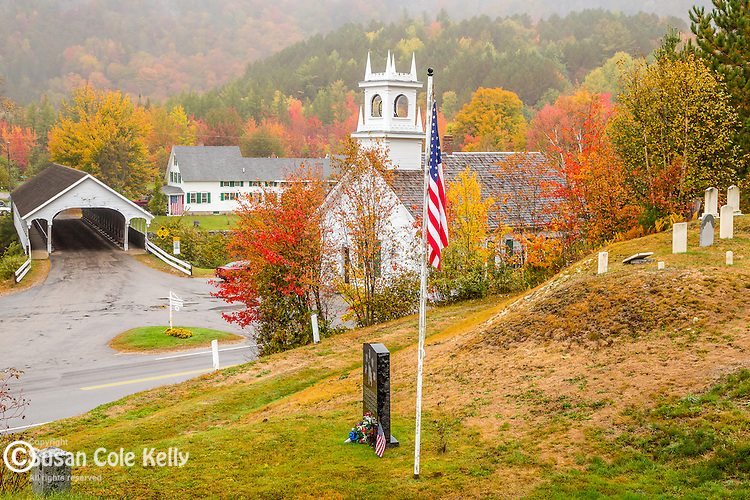 The Stark covered bridge and the Stark Union Church in fall in Stark, New Hampshire, USA