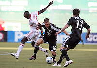 Greg Janicki  #16 of D.C. United pushes past Dominic Oduro #25 of New York Red Bulls during a U.S. Open Cup match at RFK Stadium on May 20 2009, in Washington D.C. D.C. United won 5-3.