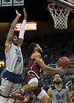 Little Rock guard Markquis Nowell (1) shoots around Nevada forward Jordan Brown (21) in the first half of an NCAA college basketball game in Reno, Nev., Friday, Nov. 16, 2018. (AP Photo/Tom R. Smedes)