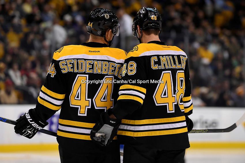 Thursday, November 19, 2015: Boston Bruins defenseman Dennis Seidenberg (44) and defenseman Colin Miller (48) talk before the start of the second period at the National Hockey League game between the Minnesota Wild and the Boston Bruins held at TD Garden, in Boston, Massachusetts. The Bruins defeat the Wild 4-2. Eric Canha/CSM