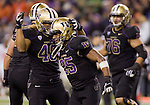 Washington Huskies full back John Amosa (48) celebrates with running back Bishop Stankey after Stankey scored a one-yard touchdown against the Oregon State Beavers at CenturyLink Field in Seattle, Washington on October 27, 2012.  Stankey rushed for 98 yards  on 25v carries and scored two touchdowns in  the Huskies  20-17 upset win over the 7th ranked Beavers.   ©2012. Jim Bryant Photo. ALL RIGHTS RESERVED.