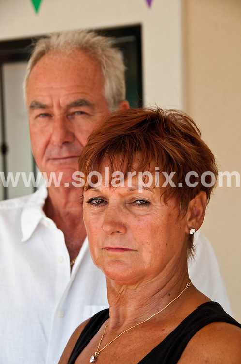 "**ALL ROUND EXCLUSIVE PICTURES FROM SOLARPIX.COM**.**WORLDWIDE SYNDICATION RIGHTS**.Ray and Maureen Harvey at home in El Campillo in Alicante, Spain..Their son Lee died after being stabbed 37 times in what was initially thought to be a road rage attack in 1996, before it later became clear that the road rage story was fabricated by his partner at the time Tracie Andrews, who played up to her story by crying at press conferences set-up to help the search for an unknown killer..Although Maureen and husband Ray, 66, campaigned for Andrews to be kept behind bars for life - they put together petitions and went to Downing Street for talks with Tony Blair - this week they have been incensed after opening a UK newspaper to see pictures of killer Andrews shopping with a friend on a day release from jail as she prepares for her full release from prison which is expected next year..Andrews has served 14 years of a life sentence for murdering fiance Lee, who she stabbed in the face, neck, back and chest after they rowed while driving to their Worcester flat..Maureen is convinced Andrews has conned prison bosses into believing she is a reformed character - and warned she could kill again. She added: ""Andrews is a cunning bitch with a violent, evil side to her. Anyone who saw her at that press conference pretending to cry tears for Lee when she knew she had stabbed the life out of him will know how vile she is. She's pulled the wool over the prison people's eyes. But she has a hair-trigger temper she can't control. Can you imagine the fury inside someone who can stab someone she is supposed to love 37 times then lie and lie to try to save her skin? I'm convinced Tracie Andrews will murder again after she gets out. There will be some incident or row in the years to come where the real Tracie Andrews surfaces and someone will die. I hate to say it and I'll have sympathy for her victim. But you can't rehabilitate someone as wicked as Tracie Andrews. Alicante, Spain. 23 August 2010.."