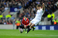 Owen Farrell of England takes a penalty kick in front of Mike Catt, England Attacking Skills Coach, during the RBS 6 Nations match between England and Scotland at Twickenham on Saturday 02 February 2013 (Photo by Rob Munro)