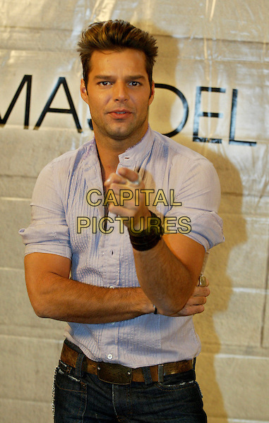 RICKY MARTIN.Ricky Martin PhotoCall at the Westin Hotel, Rotterdam, The Netherlands..April 19th, 2003.Ref: SH.half length blue shirt bracelet leather pointing.www.capitalpictures.com.sales@capitalpictures.com.©Capital Pictures