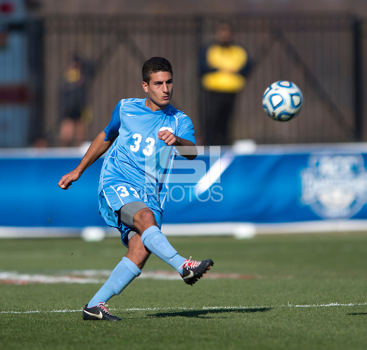 Raby George (33) of North Carolina punts the ball forward during the game at the Maryland SoccerPlex in Germantown, MD. Maryland defeated North Carolina, 2-1,  to win the ACC men's soccer tournament.