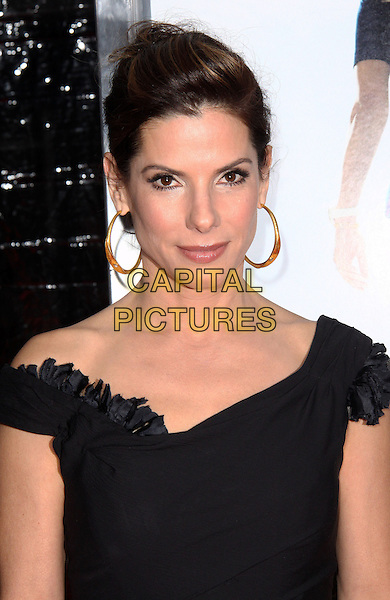 "SANDRA BULLOCK.At the New York City Premiere of ""The Blind Side"" held at the Ziegfeld Theater, New York, NY, USA, .17th November 2009..portrait headshot hair up hoop earrings gold off the shoulder .CAP/ADM/PZ.©Paul Zimmerman/AdMedia/Capital Pictures."