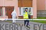 Gardai investigate the house at the centre of the murder investigation in Killorglin on Monday