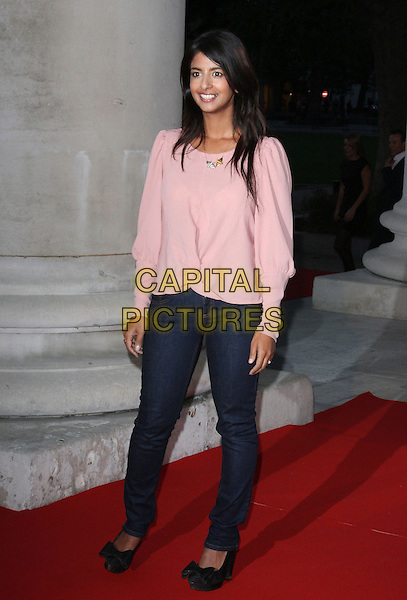 KONNIE HUQ.Your Moment Is Waiting - launch party at Saatchi Gallery, London, England..September 21st 2010.full length jeans denim pink top.CAP/ROS.©Steve Ross/Capital Pictures