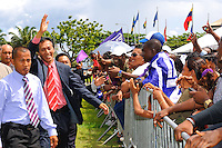 "Paul Slamet Somohardjo, former cahirman of De Nationale Assemblée (DNA) / The National Assemble of Suriname salutes NDP and ""De Mega Combinatie"" - ""The Mega Combination"" supporters after Desi Bouterse (Desiré Delano Bouterse) won the election of presidential election. ....Paul Slamet Somohardjo, Chairman of the Pertjajah Luhur and his party supported Desi Bouterse (Desiré Delano Bouterse)'s presidential candidate for three seat of ministries.....Desi Bouterse (Desiré Delano Bouterse) chosen as new president of Suriname by De Nationale Assemblée (DNA) / The National Assemble of Suriname. He took 36 votes of 51 as leader of the Mega Combination. ....Robert_Ameerali the head of KKF (Kamer van Koophandel en Fabrieken) / Chamber of Commerce and Industry also selected as Vice President.....Desi Bouterse (Desiré Delano Bouterse) will sworn at 3 August 2010"