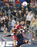 New England Revolution midfielder Diego Fagundez (14) and Chicago Fire defender Dan Gargan (3) battle for head ball. In a Major League Soccer (MLS) match, the New England Revolution (blue) defeated Chicago Fire (red), 1-0, at Gillette Stadium on October 20, 2012.